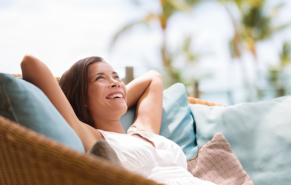 Woman relaxing on summer-friendly furniture