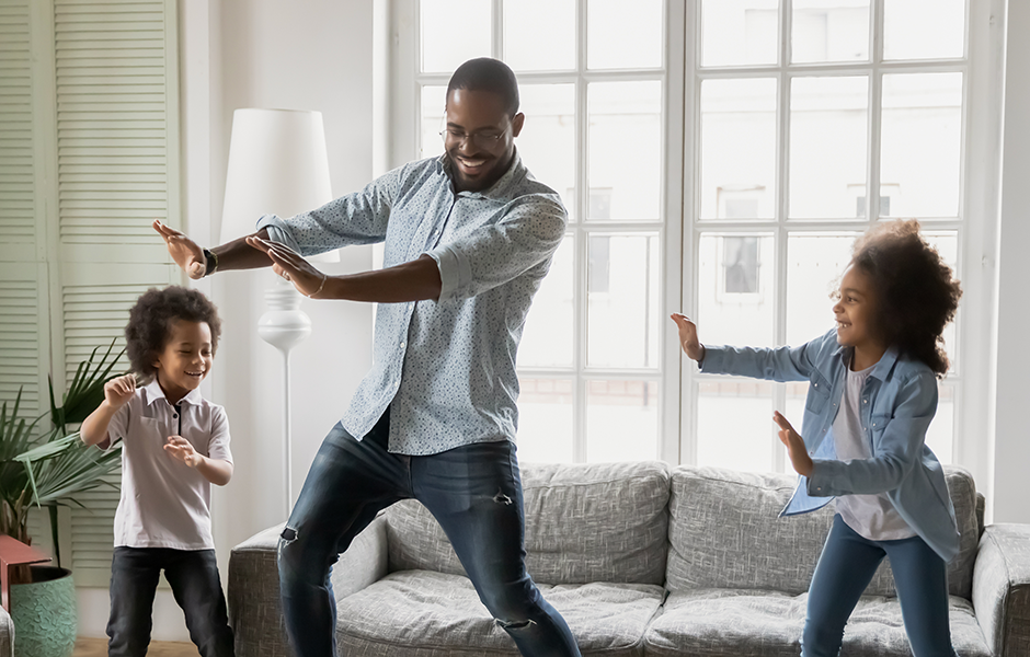 Family dancing together in living room