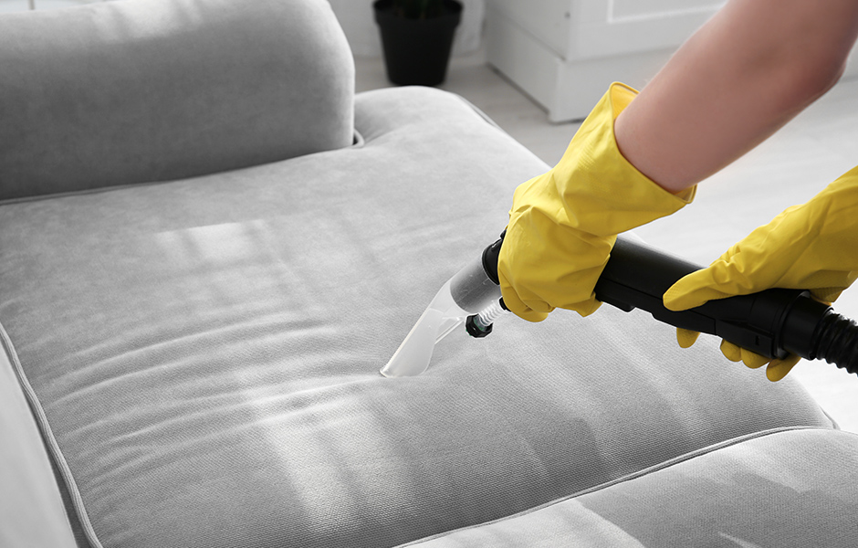 Using vacuum cleaner to clean couch