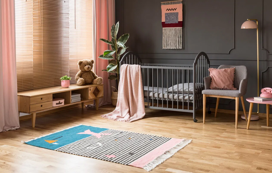 Striped rug in pink and grey nursery