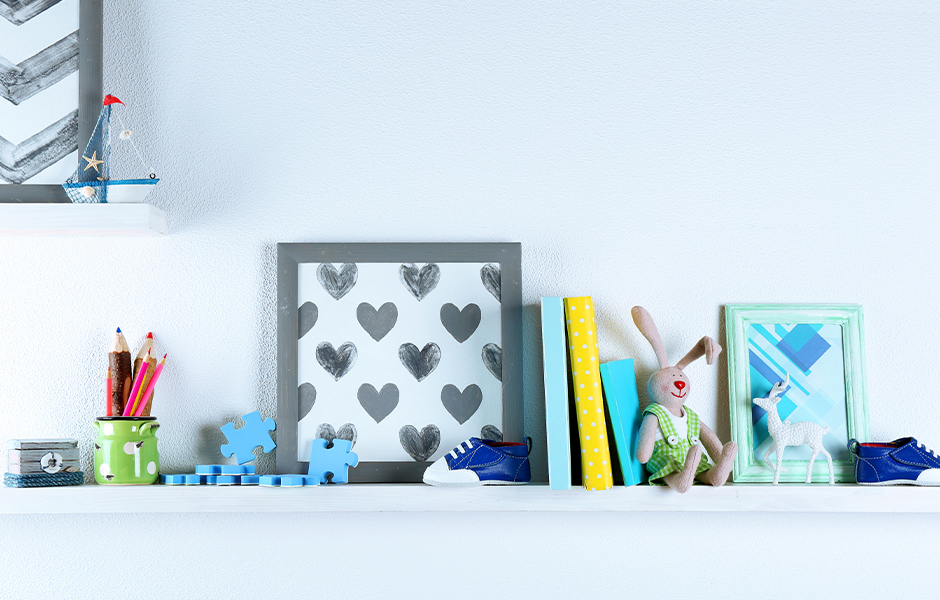 Baby books and toys on shelf