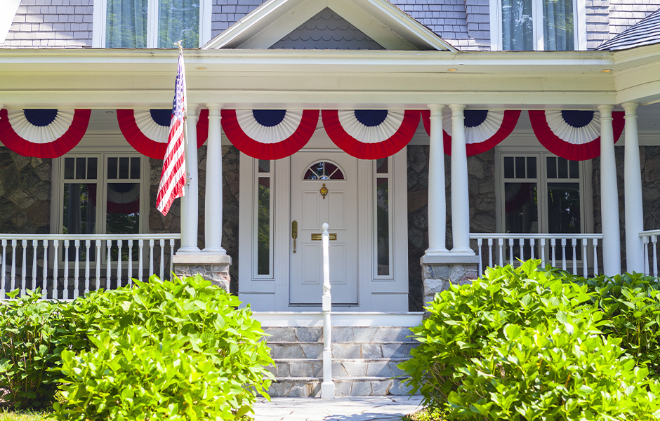 American flag bunting across front porch